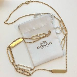 Coach long gold necklace